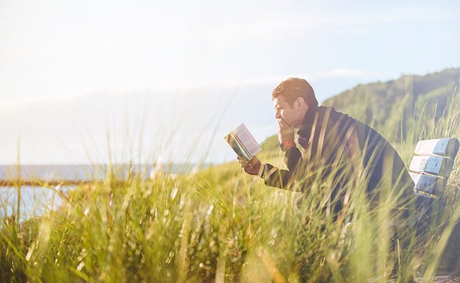 Man concentrating while reading a book