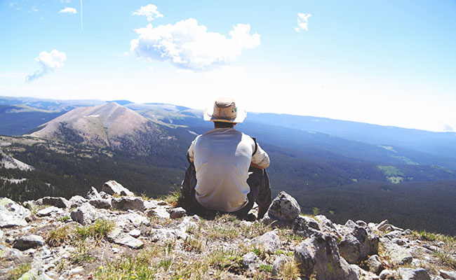 Man sitting on a mountain top